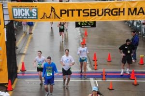 Crossing the finish line of the Pittsburgh Marathon, May 2010